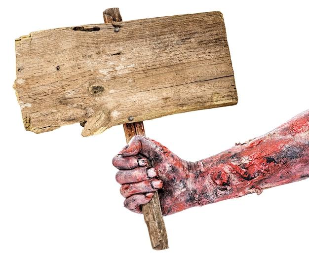 Zombie hand met bord met ruimte voor tekst, geïsoleerd wit oppervlak, copyspace, halloween hand.