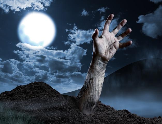 Zombiehand die uit zijn graf komt