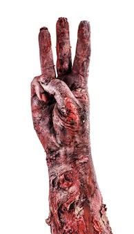 Zombiehand met drie vingers, aftellen geïsoleerd wit oppervlak, halloween-hand.