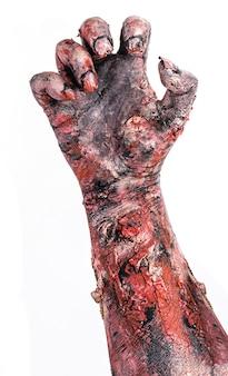 Zombiehand, ondoden, die uit de grond komen, monsterhand op geïsoleerd wit oppervlak.