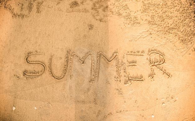 Zomer geschreven in het zand