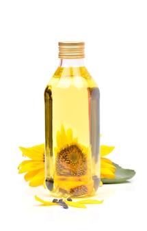 Zonnebloem met olie op een witte achtergrond