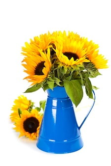 Zonnebloemen in een blauwe vaas