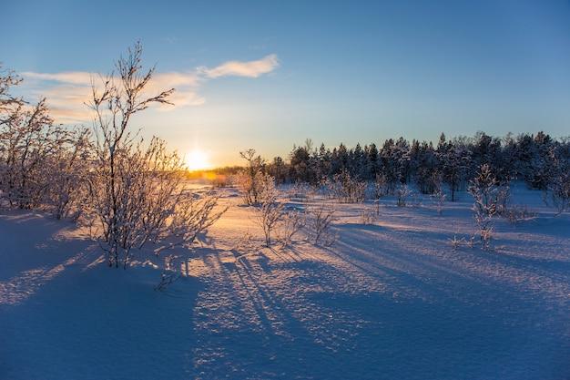 Zonsondergang winterlandschap
