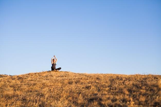 Zonsondergang yogalessen.