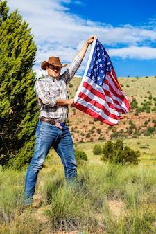 Zuidwesten - een cowboy heeft tijd nodig om te rusten en na te denken. Premium Foto