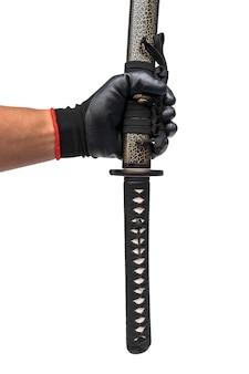 Zwaard, mes bij de hand met zwarte handschoen