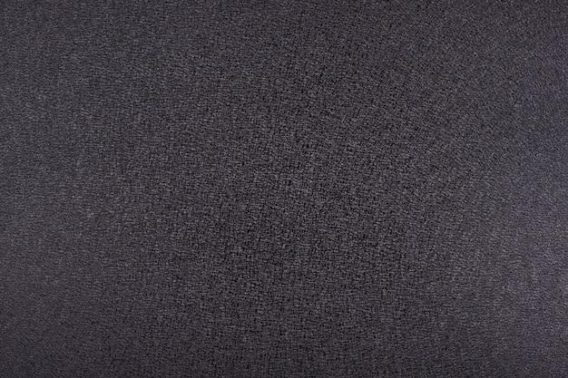 Zwart, donkergrijs, antraciet achtergrond. ruwe textuur.