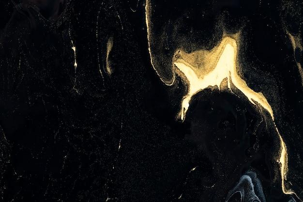 Zwart en goud vloeibare marmeren achtergrond diy elegante vloeiende textuur experimentele kunst