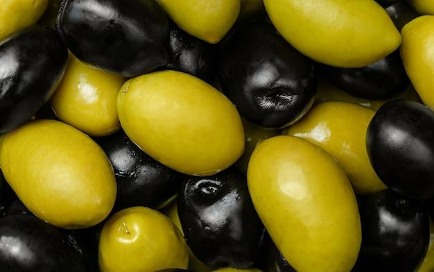 Zwart en groen olijvenpatroon. bovenaanzicht, plat gelegd