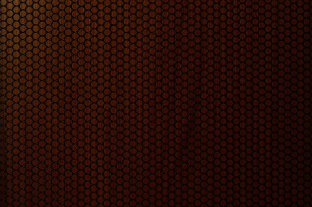 Zwart geperforeerd metalen luidsprekerrooster zwart staal metalen rooster achtergrond textuur cirkel gat