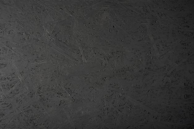 Zwart geverfde osb-plaat.