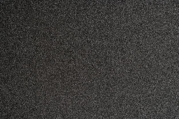 Zwart glinsterend gestructureerd achtergrondontwerp