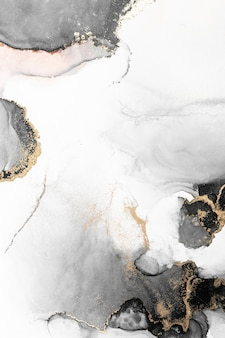 Zwart goud abstracte achtergrond van marmeren vloeibare inkt kunst schilderij op papier.