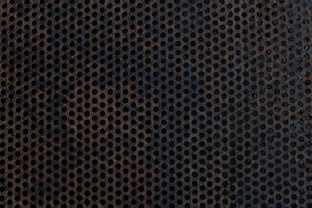 Zwart ijzeren oppervlak met gaten