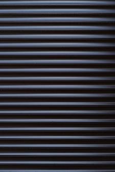 Zwart ijzeren tinnen hek bekleed achtergrond. metalen structuur
