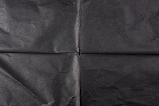 Zwart papier met vouwen. papier textuur.