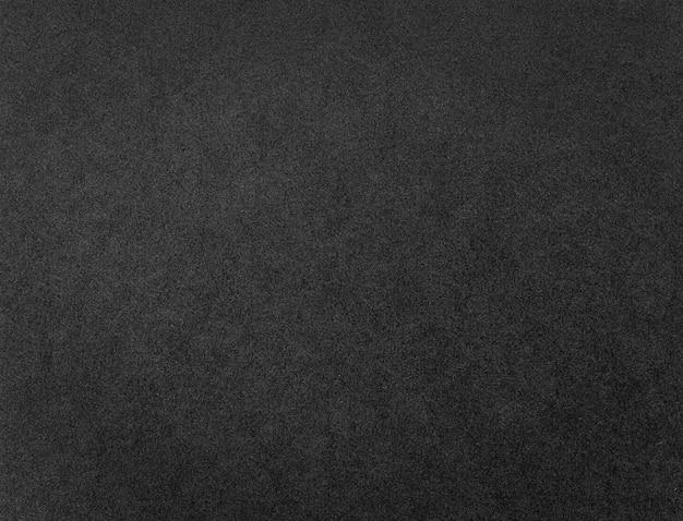 Zwart papier textuur of achtergrond. kartonnen grunge patroon