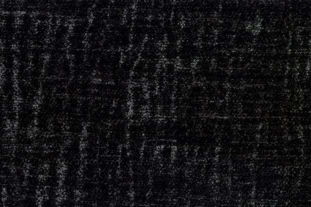 Zwart pluizig oppervlak van zachte, wollige stof