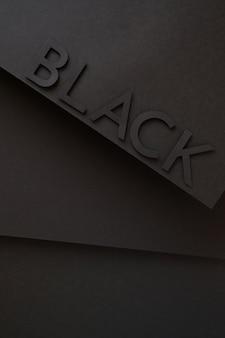 Zwart schattig van papier op zwarte achtergrond belettering