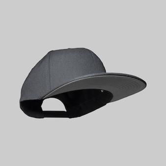Zwart snapback cap vliegend concept