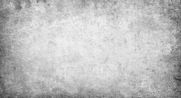 Zwart-wit, grijze grungeachtergrond, oud ontwerpdocument textuur met exemplaarruimte en ruimte voor tekst