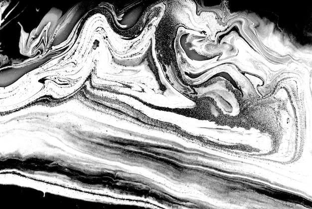 Zwart-wit marmering achtergrond. unieke kunstwerktextuur. imitatie marmerverf.