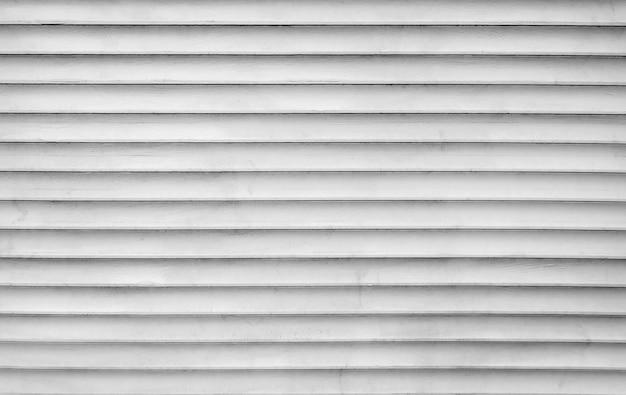 Zwart-wit patroon van blanco gebarsten planken. detailopname