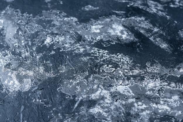 Zwart-witte achtergrond met een mat oppervlak. textuur
