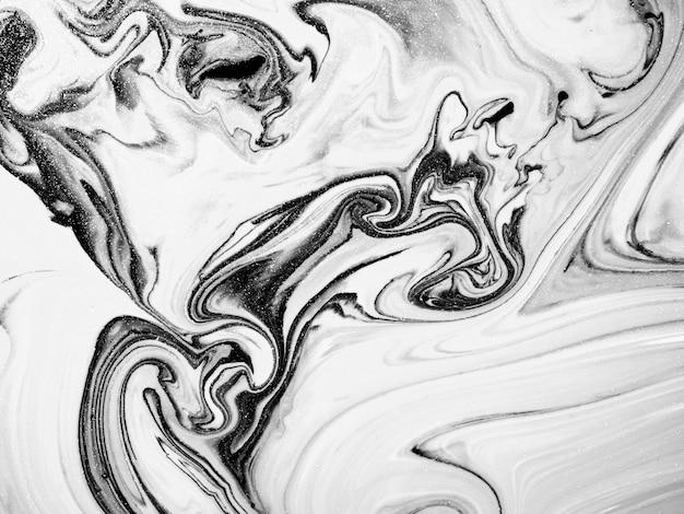 Zwart-witte acrylverftextuur met abstracte organische vormen