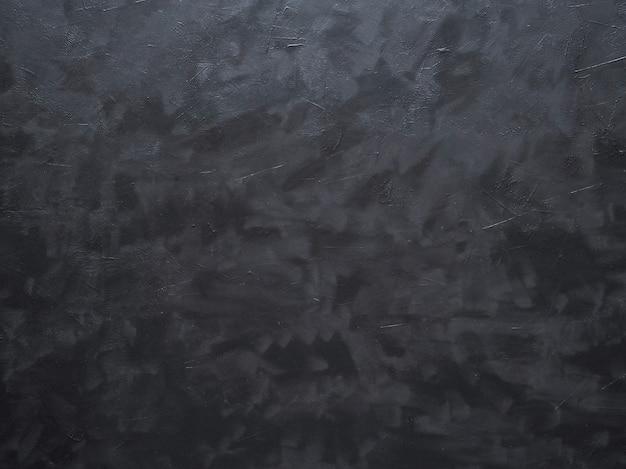 Zwarte abstracte achtergrond van beton en email.