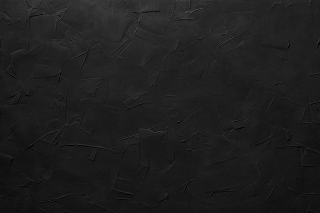 Zwarte abstracte gestructureerde achtergrond. gips op de muur.