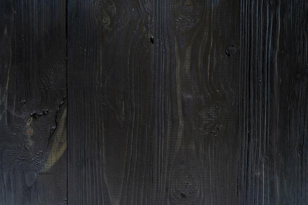 Zwarte achtergrond donkere leisteen steen textuur vignet. betonnen ondergrond