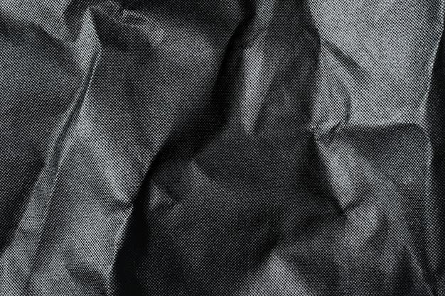 Zwarte achtergrond luxe doek golf textuur.