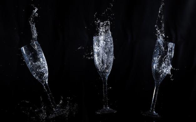 Zwarte achtergrond met kristallen glazen in beweging