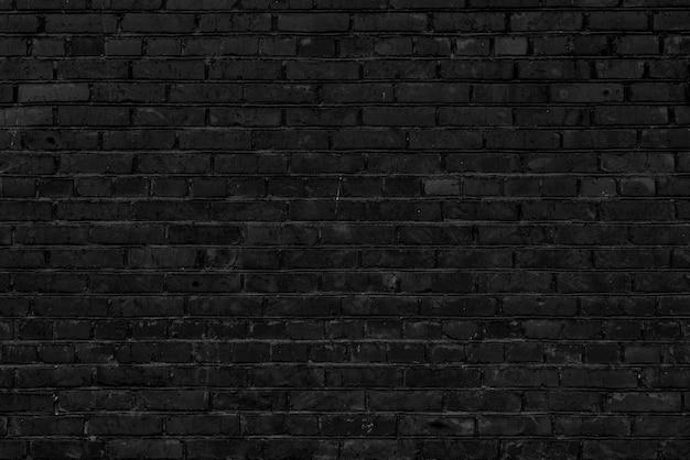 Zwarte bakstenen bouwmuur. interieur van een moderne loft. achtergrond voor ontwerp