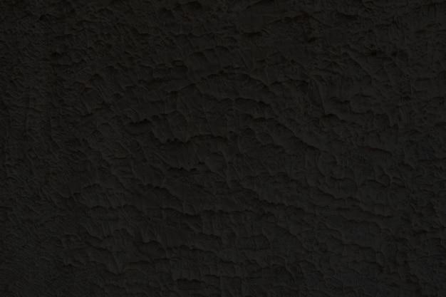 Zwarte bakstenen en concrete textuur voor patroon abstracte achtergrond.