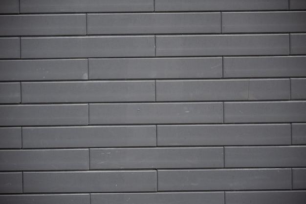 Zwarte bakstenen muur achtergrond Premium Foto