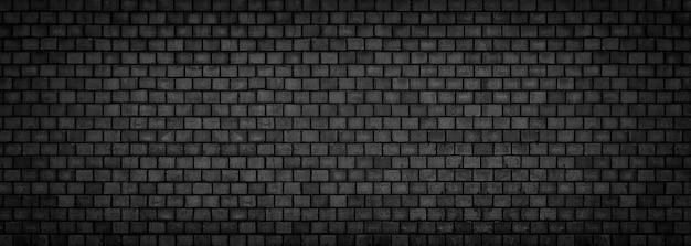 Zwarte bakstenen muur, brede panoramische steenoppervlaktetextuur