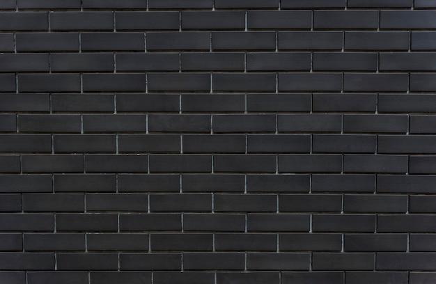 Zwarte bakstenen muur getextureerde achtergrond