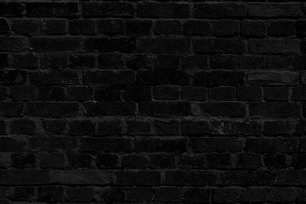 Zwarte bakstenen muur. loft interieur. zwarte verf van de gevel.