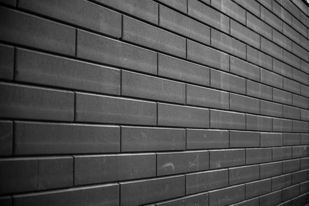 Zwarte bakstenen muur. stedelijke zwarte bakstenen muur textuur metselwerk achtergrond.
