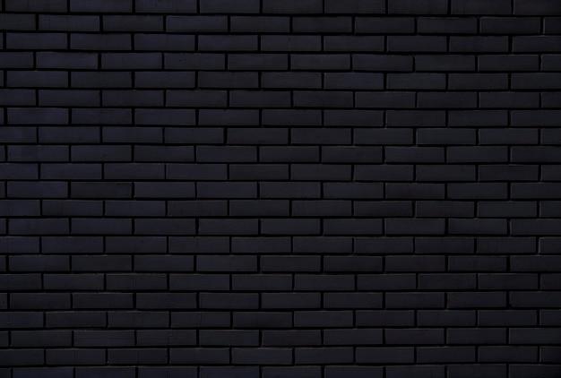 Zwarte bakstenen muur voor achtergrond en textuur