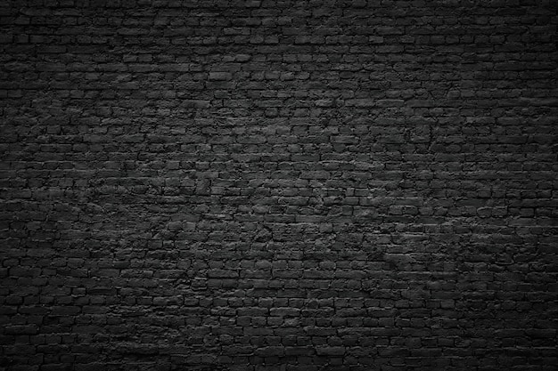 Zwarte bakstenen muurachtergrond, uitstekende steentextuur