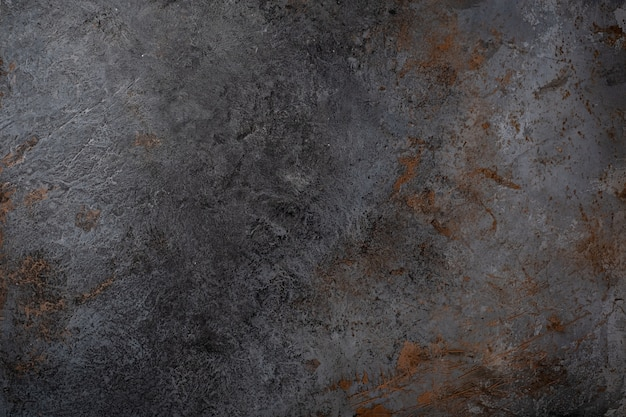 Zwarte betonnen muur textuur ruwe vorm met scheuren en bezuinigingen