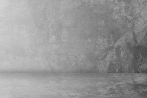 Zwarte cementstudio en donkere toonzaalachtergrond