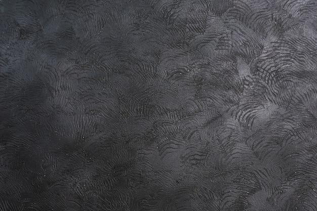 Zwarte concrete textuur als achtergrond met exemplaarruimte