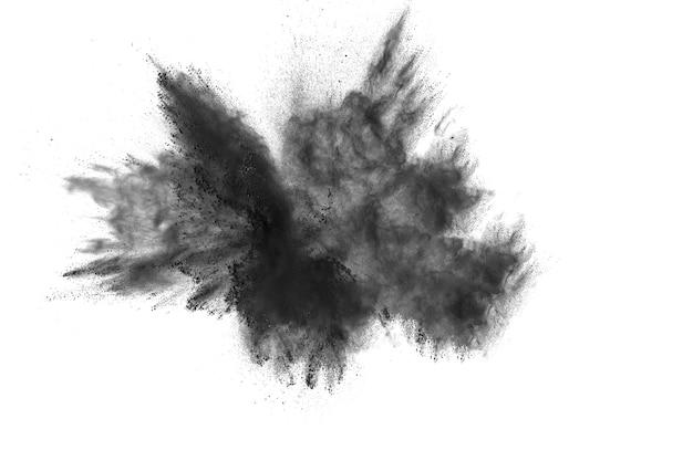 Zwarte deeltjes splatter op witte achtergrond.