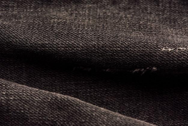 Zwarte denim stof textuur. stof patroon textuur van denim of zwarte jeans voor de ontwerp abstracte achtergrond.