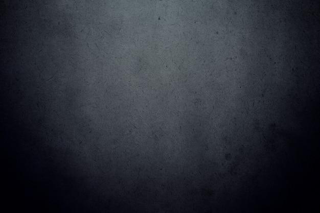 Zwarte donkere verloop muur met korrelige vuile textuur achtergrond